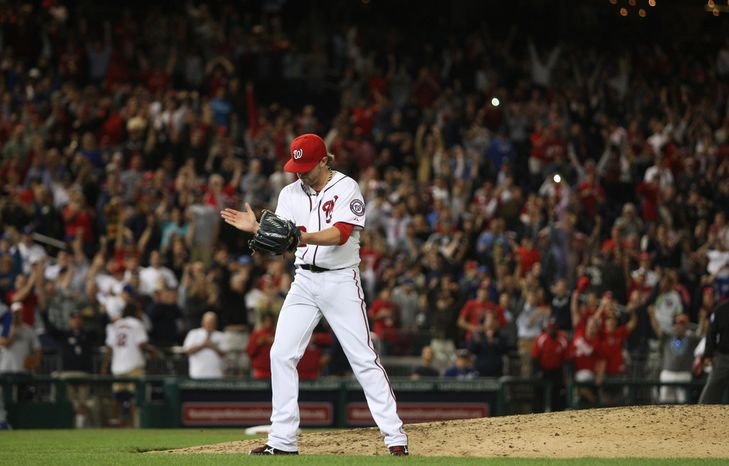 Washington Nationals Washington Nationals relief pitcher Drew Storen (22) celebrate after throwing the final strike out to beating the Los Angeles Dodgers 4-1at Nationals Park, Thursday, Sept. 20, 2012, in Washington, DC. The Washington Nationals clinched a spot in the playoff for the first time in team history. (Craig Bisacre/The Washington Times)
