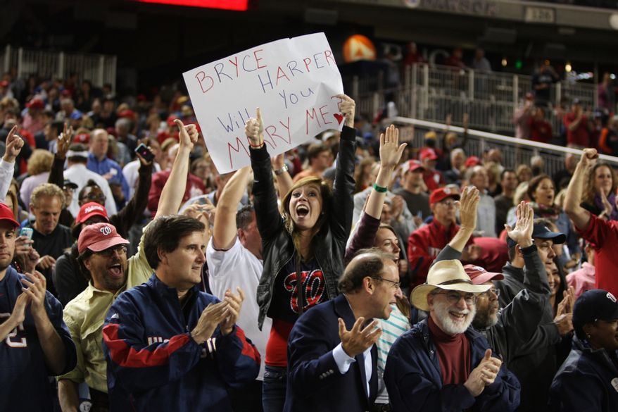 Fans celebrate after the Washington Nationals beating the Los Angeles Dodgers 4-1at Nationals Park, Thursday, Sept. 20, 2012, in Washington, DC. The Washington Nationals clinched a spot in the playoff for the first time in team history. (Craig Bisacre/The Washington Times)