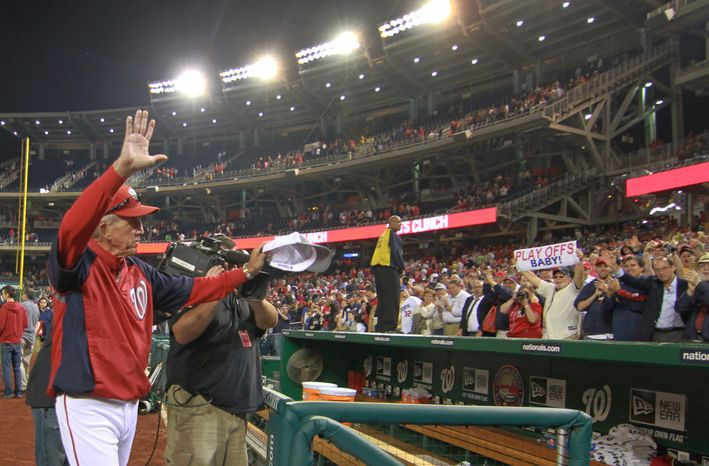 Washington Nationals manager Davey Johnson (5) celebrates after beating the Los Angeles Dodgers 4-1at Nationals Park, Thursday, Sept. 20, 2012, in Washington, DC. The Washington Nationals clinched a spot in the playoff for the first time in team history. (Craig Bisacre/The Washington Times)