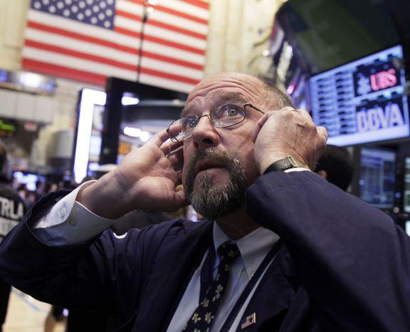 Trader Frederick Reimer works on the floor of the New York Stock Exchange on Thursday, Sept. 20, 2012, in New York. (AP Photo/Richard Drew)