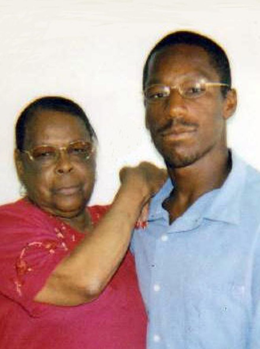This undated image of former gang member John Edward Smith shows him posing with his grandmother, Laura Neal. Prosecutors are seeking dismissal of charges against Smith, who was convicted of a drive-by murder in a gang-infested neighborhood of Los Angeles in 1993. (Associated Press/Deirdre O'Connor)
