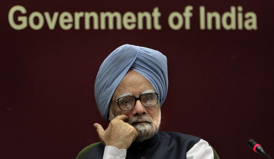 ** FILE ** Indian Prime Minister Manmohan Singh listens to a speaker during a conference in New Delhi on Nov. 23, 2010. (Associated Press)