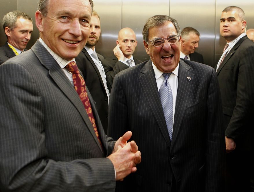 U.S. Secretary of Defense Leon Panetta laughs Sept. 21, 2012, with Auckland War Memorial Museum director Roy Clare (left) in an elevator at the museum in Auckland, New Zealand, after presenting medals to New Zealand Defense Force Service members for their service in Afghanistan. (Associated Press)