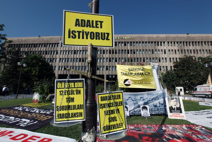 **FILE** The portraits of people who were executed, died or disappeared in jails during military rule after Turkey's 1980 coup, according to protesters and family members, are displayed outside a courthouse in Ankara, Turkey, on Sept. 14, 2012. (Associated Press)