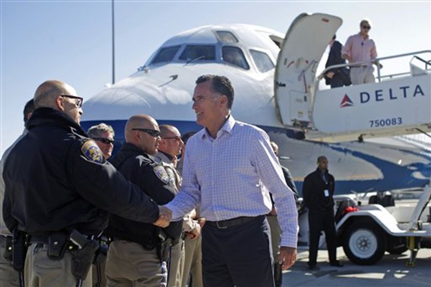 Republican presidential candidate and former Massachusetts Gov. Mitt Romney boards his campaign plane in San Francisco, Saturday, Sept. 22, 2012. (AP Photo/Charles Dharapak)