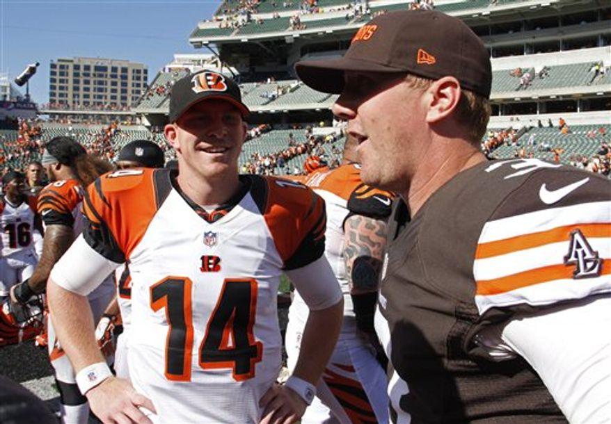 ** FILE ** Cincinnati Bengals quarterback Andy Dalton (14) meets with quarterback Brandon Weeden (3) after an NFL football game, Sunday, Sept. 16, 2012, in Cincinnati. (AP Photo/Tom Uhlman)