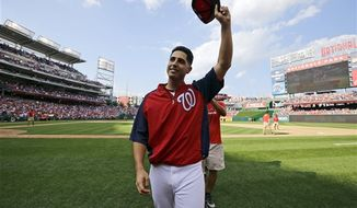 ** FILE ** Washington Nationals starting pitcher Gio Gonzalez acknowledges the crowd after a baseball game against the Milwaukee Brewers at Nationals Park Saturday, Sept. 22, 2012, in Washington. It was Gonzalez's 20th win of the season, and the Nationals won 10-4. (AP Photo/Alex Brandon)
