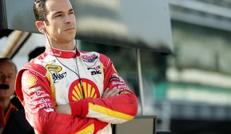 IndyCar driver Helio Castroneves, of Brazil, watches from the pit area during practice on the first day of qualifications for the Indianapolis 500 auto race at the Indianapolis Motor Speedway in Indianapolis, Saturday, May 19, 2012. (AP Photo/AJ Mast)