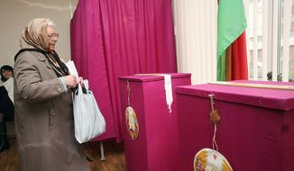 A Belarusian woman prepares to cast her ballot at a polling station during parliamentary elections in Minsk on Sunday. Belarus held parliamentary elections Sunday without the main opposition parties, which boycotted the vote to protest the detention of political prisoners and opportunities for election fraud. (Associated Press)