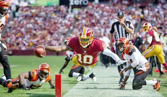 Robert Griffin III (10) goes airborne for the pylon, but the Redskins quarterback had stepped out of bounds a few yards back. Griffin carried 12 times for 85 yards and a touchdown in his FedEx Field debut. (Andrew Harnik/The Washington Times)