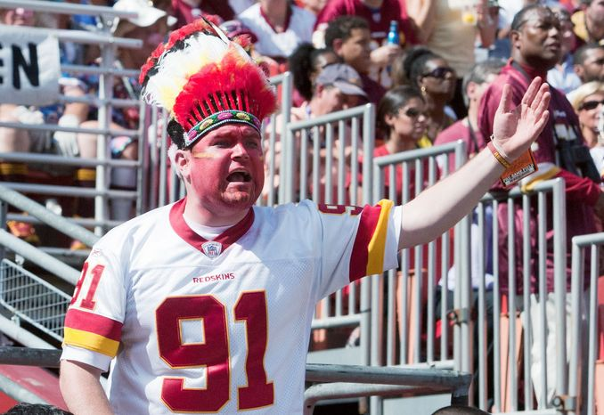 Fans react to ruling on the field during the first half of the the Washington Redskins against the Cincinnati Bengals, Landover, Md., Sunday, September 23, 2012. (Craig Bisacre/The Washington Times)