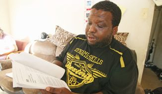 Dwayne Hogue made a wrong turn from in March 2011 and headed into the District from Maryland, where his gun was legal. His car was pulled over by police, and he was arrested for having a firearm. The D.C. Council Judiciary Committee will hold a hearing this week on cases like his. (Craig Bisacre/The Washington Times)