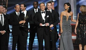 "Alex Gansa (center) and the cast and crew of ""Homeland"" accept the award for outstanding drama series at the 64th Primetime Emmy Awards at the Nokia Theatre on Sunday, Sept. 23, 2012, in Los Angeles. (John Shearer/Invision/AP)"