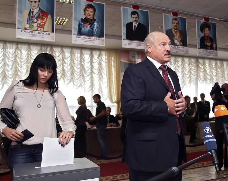 Belarusian President Alexander Lukashenko speaks to the media at a polling station after voting in parliamentary elections in Minsk, Belarus, on Sunday, Sept. 23, 2012. The main opposition parties boycotted the vote to protest the detention of political prisoners and opportunities for election fraud. (AP Photo/Sergei Grits)