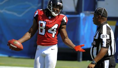 Atlanta Falcons wide receiver Roddy White, left, argues with official Derra Ramsey during the first half of an NFL football game against the San Diego Chargers in San Diego, Sunday, Sept. 23, 2012. (AP Photo/Denis Poroy)