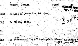 """This undated image obtained by the Associated Press from the National Archives through a Freedom of Information Act request shows a U.S. Army intelligence card on Johann """"Hans"""" Breyer, indicating he was serving in Auschwitz death camp in Nazi-occupied Poland as of Dec. 29, 1944 — four months after he said he deserted.  (AP Photo/National Archives)"""
