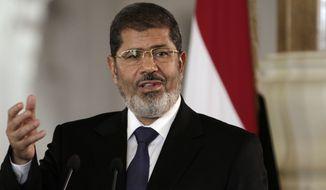 ** FILE ** Egyptian President Mohammed Morsi (AP Photo/Maya Alleruzzo)