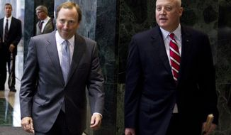 ** FILE ** This Aug. 14, 2012, file photo shows NHL commissioner Gary Bettman, left, and Bill Daly, deputy commissioner and chief legal officer, following collective bargaining talks in Toronto. Daly says the owners and players are both to blame for their failure to reach a new collective bargaining agreement before the Saturday deadline for a work stoppage.  Daly wrote in an email to The Associated Press that he hoped both sides would meet before Saturday. (AP Photo/The Canadian Press, Chris Young, File)