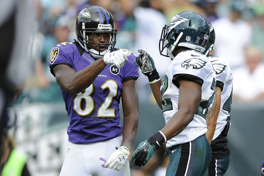 Baltimore Ravens wide receiver Torrey Smith (82) and Philadelphia Eagles cornerback Brandon Boykin (22) exchange words in the endzone during the second half of an NFL football game on Sunday, Sept. 16, 2012, in Philadelphia. (AP Photo/Michael Perez)