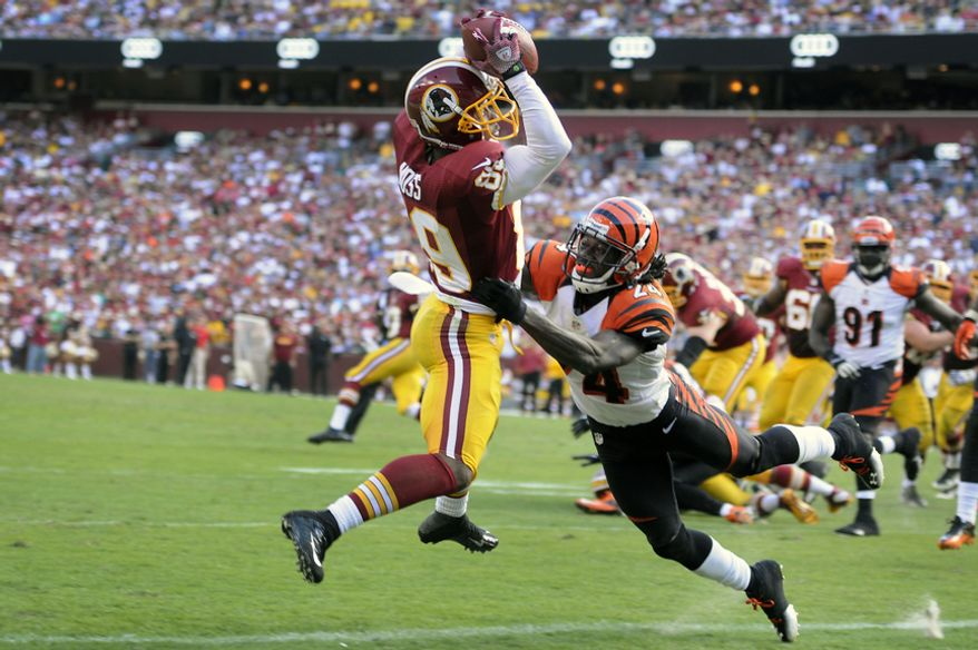 Washington Redskins wide receiver Santana Moss (89) hauls in a third quarter touchdown in front of Cincinnati Bengals cornerback Adam Jones (24) at FedEx Field, Landover, Md., Sep. 23, 2012. (Preston Keres/Special to The Washington Times)