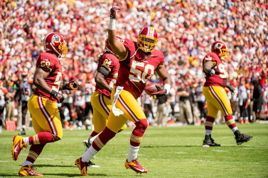 Washington Redskins linebacker Rob Jackson (50) celebrates his intercept for a touchdown in the first quarter as the Washington Redskins play the Cincinnati Bengals on their home opener at FedEx Field, Landover, Md., Sunday, September 23, 2012. (Andrew Harnik/The Washington Times)