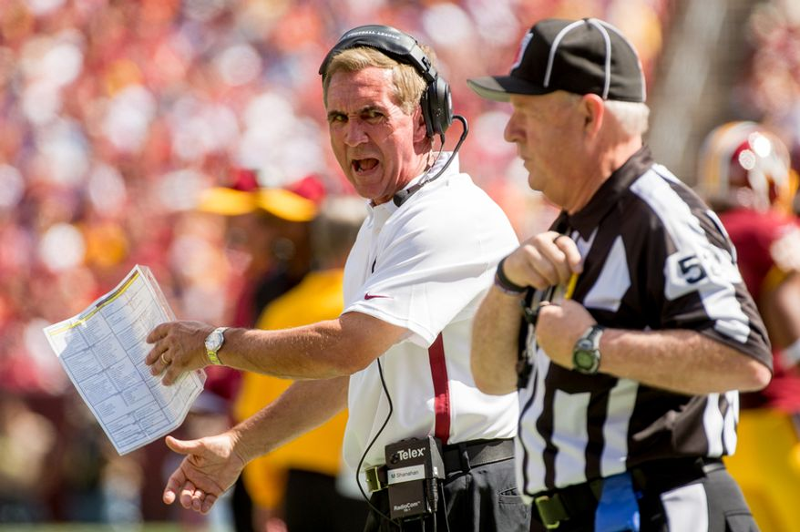 Washington Redskins head coach Mike Shanahan yells at a ref in the first half as the Washington Redskins play the Cincinnati Bengals on their home opener at FedEx Field, Landover, Md., Sunday, September 23, 2012. (Andrew Harnik/The Washington Times)