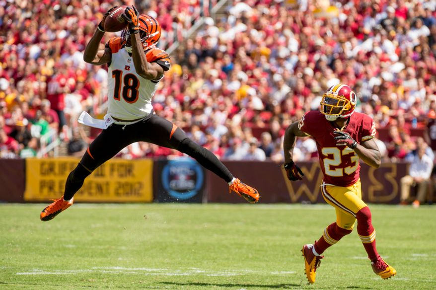 Cincinnati Bengals wide receiver A.J. Green (18) makes a 5 yard reception against Washington Redskins cornerback DeAngelo Hall (23) at the end of the first quarter as the Washington Redskins play the Cincinnati Bengals on their home opener at FedEx Field, Landover, Md., Sunday, September 23, 2012. (Andrew Harnik/The Washington Times)