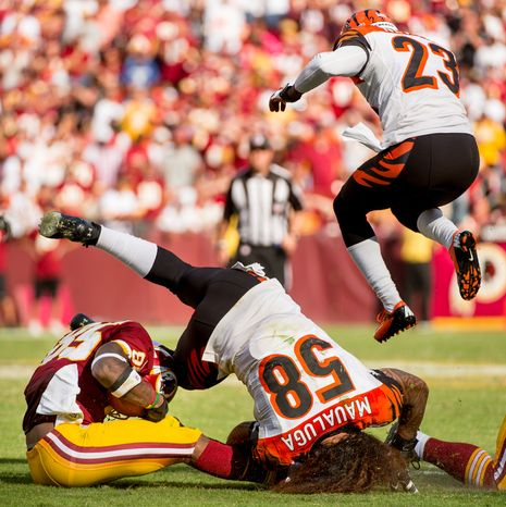 Washington Redskins wide receiver Leonard Hankerson (85) is injured after colliding with Cincinnati Bengals linebacker Rey Maualuga (58) on a 12 yard gain as the Washington Redskins lose to the Cincinnati Bengals 38-31 on their home opener at FedEx Field, Landover, Md., Sunday, September 23, 2012. (Andrew Harnik/The Washington Times)