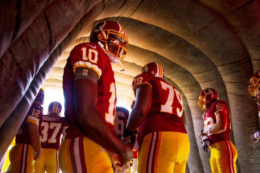 Washington Redskins quarterback Robert Griffin III (10) waits to be announced before the Washington Redskins play the Cincinnati Bengals. (Andrew Harnik/The Washington Times)