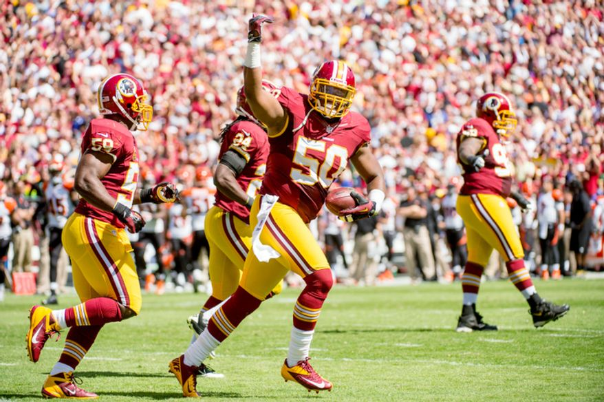 Washington Redskins linebacker Rob Jackson (50) celebrates his intercept for a touchdown in the first quarter. (Andrew Harnik/The Washington Times)