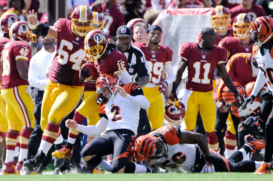 Washington Redskins wide receiver Brandon Banks (16) returns a kickoff 55 yards before being taken down by Cincinnati Bengals kicker Mike Nugent (2) in the second quarter. (Preston Keres/Special to The Washington Times)