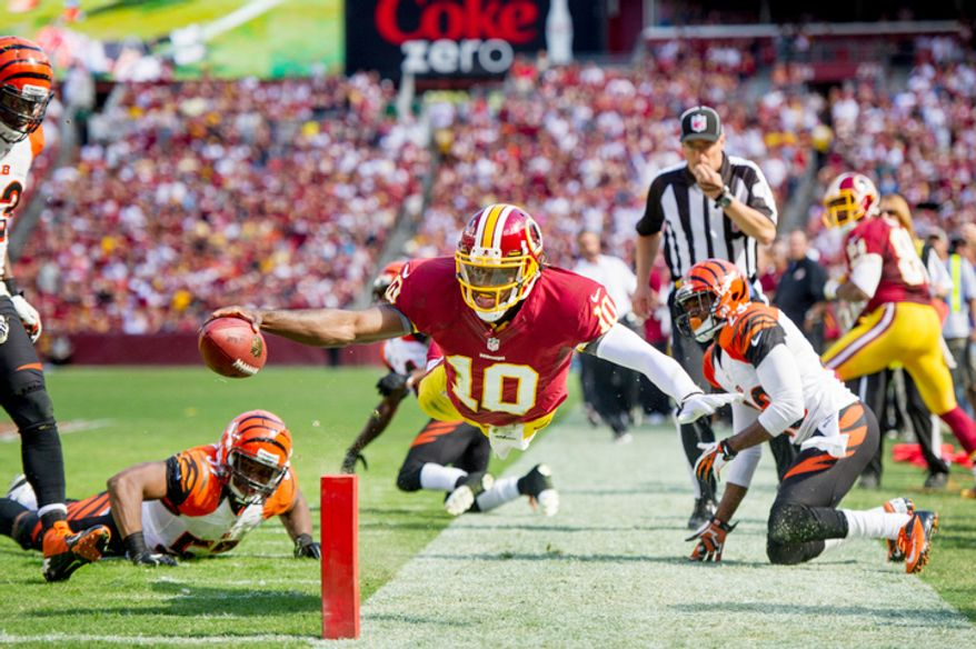 Washington Redskins quarterback Robert Griffin III (10) had just stepped out as he dives for the end zone in the second quarter2. (Andrew Harnik/The Washington Times)