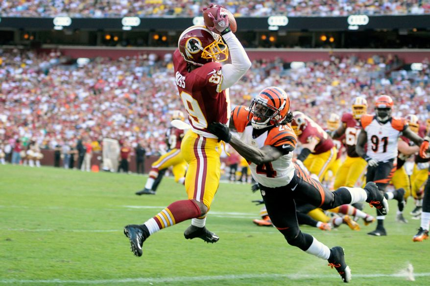 Washington Redskins wide receiver Santana Moss (89) hauls in a third quarter touchdown in front of Cincinnati Bengals cornerback Adam Jones (24). (Preston Keres/Special to The Washington Times)