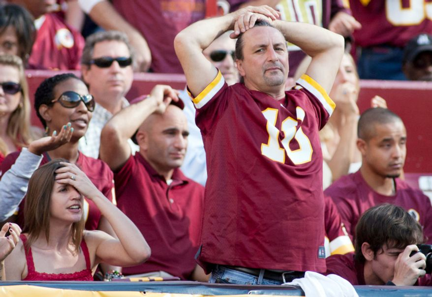 Washington Redskins fan reacts to call during the second half of the Washington Redskins against the Cincinnati Bengals.  (Craig Bisacre/The Washington Times)