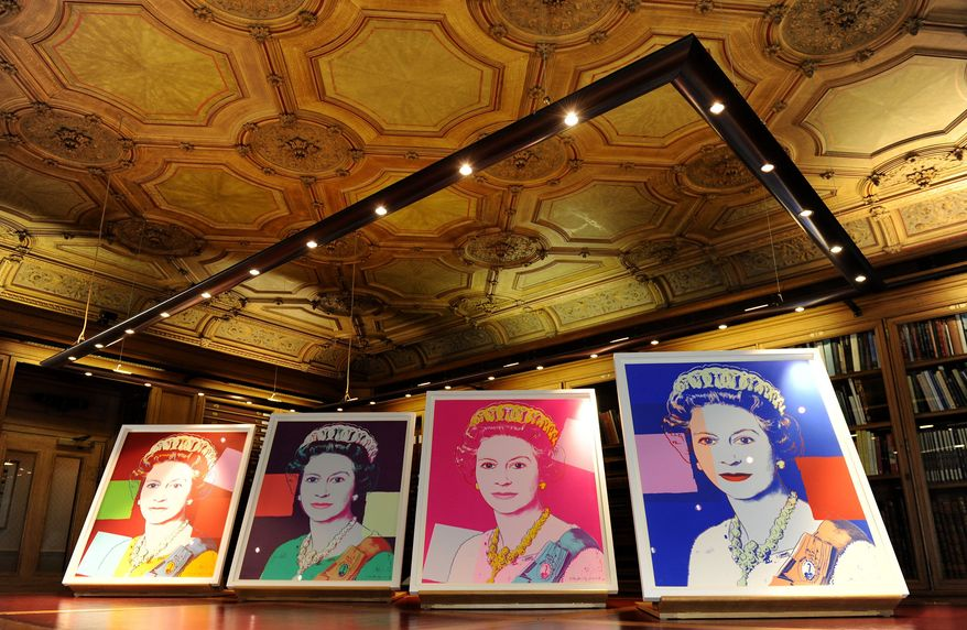 "Four Andy Warhol portraits of Queen Elizabeth II, purchased by the Royal Collection Trust, will form part of the ""Portraits of a Monarch"" exhibit opening in November at Windsor Castle outside London. (AP Photo/PA, Andrew Matthews)"