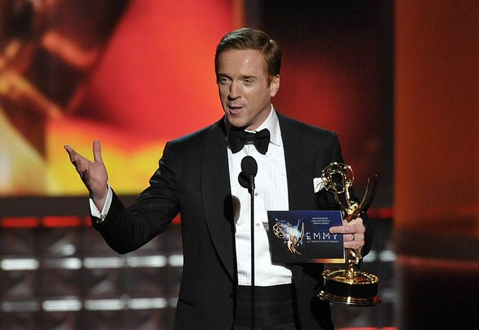 "Damian Lewis accepts the award for Outstanding Lead Actor an a Drama Series for ""Homeland"" at the 64th Primetime Emmy Awards at the Nokia Theatre on Sunday, Sept. 23, 2012, in Los Angeles. (John Shearer/Invision/AP)"