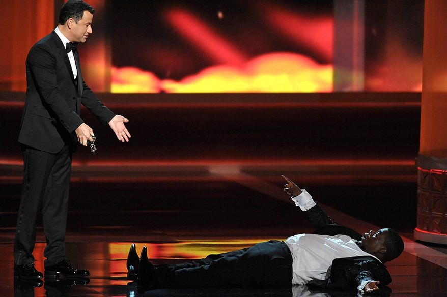 Host Jimmy Kimmel (left) and Tracy Morgan perform onstage at the 64th Primetime Emmy Awards at the Nokia Theatre on Sunday, Sept. 23, 2012, in Los Angeles. (John Shearer/Invision/AP)