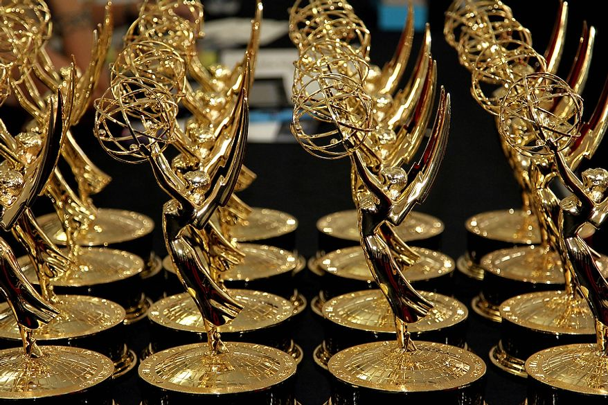 Statuettes for the 64th Primetime Emmy Awards are displayed on a table backstage at the Nokia Theatre on Sunday, Sept. 23, 2012, in Los Angeles. (Matt Sayles/Invision/AP)