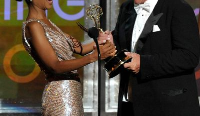"Kerry Washington (left) presents the award for Outstanding Supporting Actor an a Miniseries or Movie to Tom Berenger for ""Hatfields & McCoys"" at the 64th Primetime Emmy Awards at the Nokia Theatre on Sunday, Sept. 23, 2012, in Los Angeles. (John Shearer/Invision/AP)"