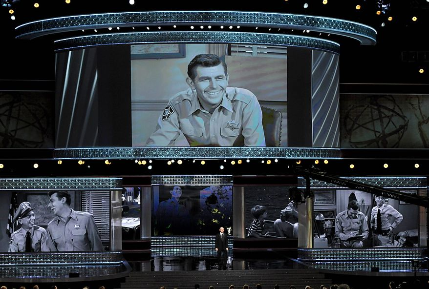 """Ron Howard presents an """"In Memorial"""" at the 64th Primetime Emmy Awards at the Nokia Theatre on Sunday, Sept. 23, 2012, in Los Angeles. Pictured onscreen is Andy Griffith. (John Shearer/Invision/AP)"""