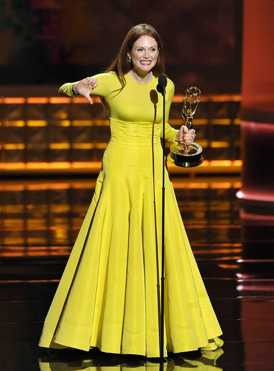 "Actress Julianne Moore, Emmy winner as the Outstanding Lead Actress in a Miniseries or Movie for ""Game Change,"" appears onstage at the 64th Primetime Emmy Awards at the Nokia Theatre on Sunday, Sept. 23, 2012, in Los Angeles. (John Shearer/Invision/AP)"