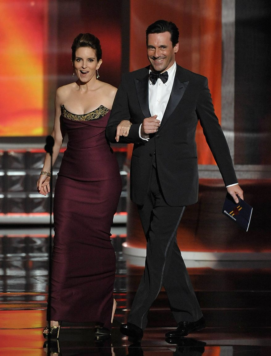 Tina Fey and Jon Hamm present an award onstage at the 64th Primetime Emmy Awards at the Nokia Theatre on Sunday, Sept. 23, 2012, in Los Angeles. (John Shearer/Invision/AP)