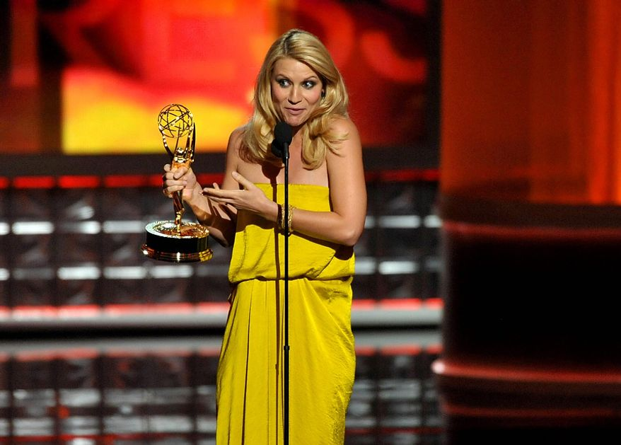 "Claire Danes accepts the award for Outstanding Lead Actress in a Drama Series for ""Homeland"" at the 64th Primetime Emmy Awards at the Nokia Theatre on Sunday, Sept. 23, 2012, in Los Angeles. (John Shearer/Invision/AP)"