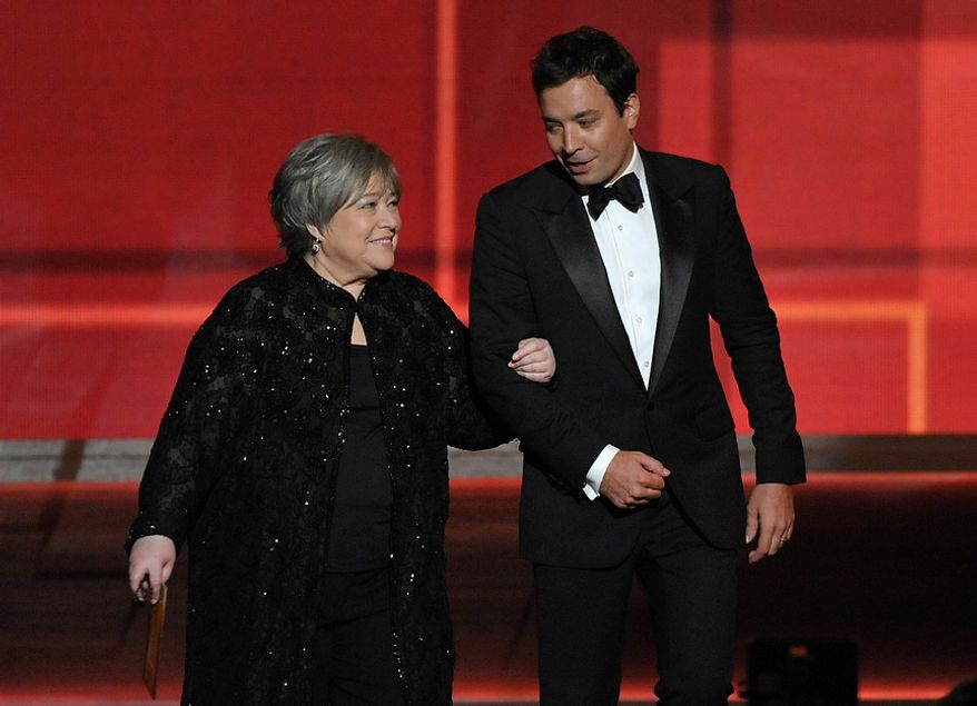 Kathy Bates and Jimmy Fallon present an award at the 64th Primetime Emmy Awards at the Nokia Theatre on Sunday, Sept. 23, 2012, in Los Angeles. (John Shearer/Invision/AP)