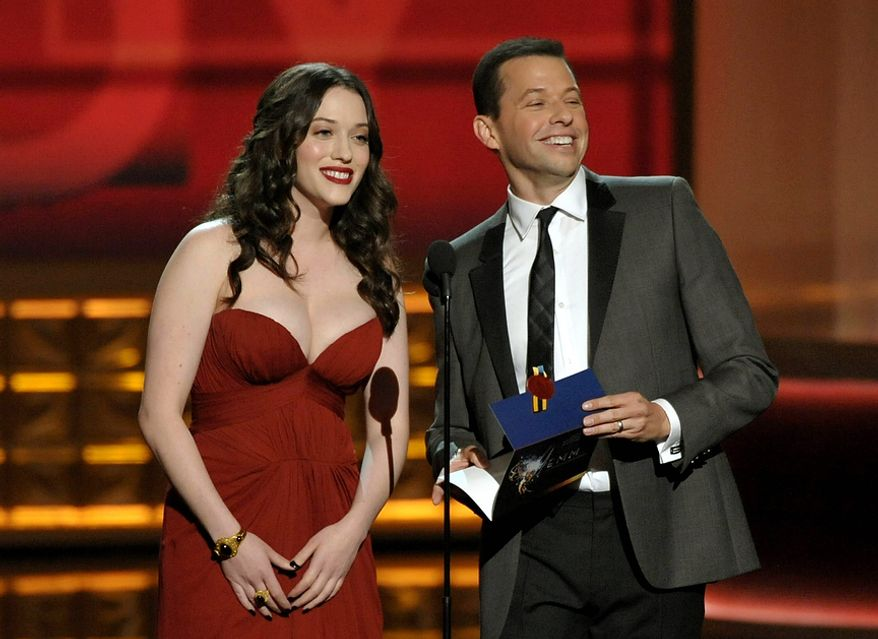 Kat Dennings (left) and Jon Cryer present an award at the 64th Primetime Emmy Awards at the Nokia Theatre on Sunday, Sept. 23, 2012, in Los Angeles. (John Shearer/Invision/AP)