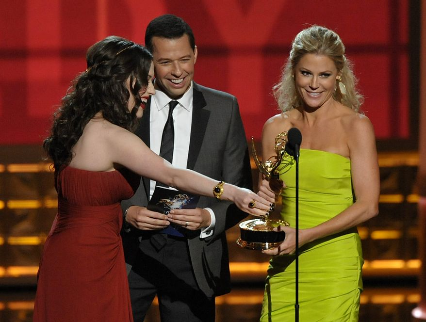 """Kat Dennings (left) and Jon Cryer (center) present the award for Outstanding Supporting Actress in a Comedy Series to Julie Bowen for """"Modern Family"""" at the 64th Primetime Emmy Awards at the Nokia Theatre on Sunday, Sept. 23, 2012, in Los Angeles. (John Shearer/Invision/AP)"""