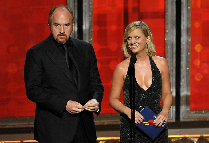 Louis C.K. and Amy Poehler present an award at the 64th Primetime Emmy Awards at the Nokia Theatre on Sunday, Sept. 23, 2012, in Los Angeles. (John Shearer/Invision/AP)
