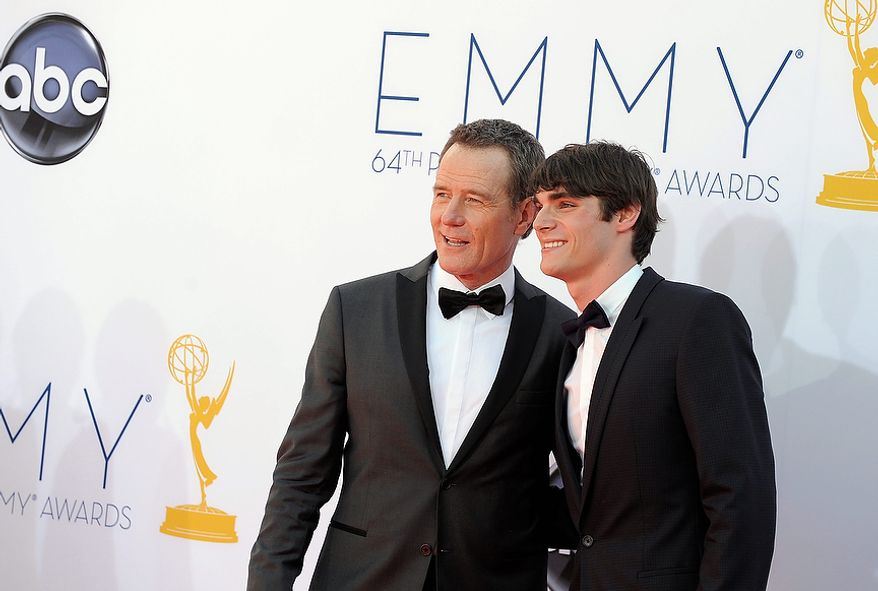 Actors Bryan Cranston, left and RJ Mitte arrive at the 64th Primetime Emmy Awards at the Nokia Theatre on Sunday, Sept. 23, 2012, in Los Angeles.  (Photo by Jordan Strauss/Invision/AP)