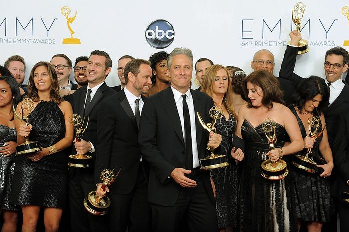 "Jon Stewart, winner Outstanding Varety Series for ""The Daily Show With Jon Stewart"", center, poses backstage with his staff at the 64th Primetime Emmy Awards at the Nokia Theatre on Sunday, Sept. 23, 2012, in Los Angeles. (Photo by Jordan Strauss/Invision/AP)"