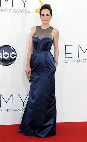 """Actress Michelle Dockery from """"Downton Abbey"""" arrives at the 64th Primetime Emmy Awards at the Nokia Theatre on Sunday, Sept. 23, 2012, in Los Angeles. (Photo by Matt Sayles/Invision/AP)"""